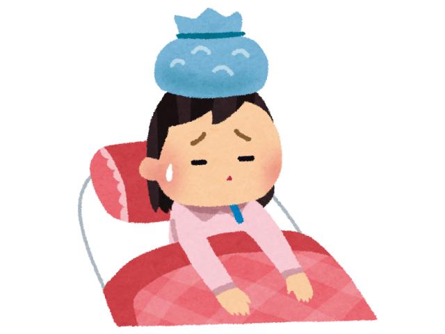 風邪を引いて寝込んでいる女性