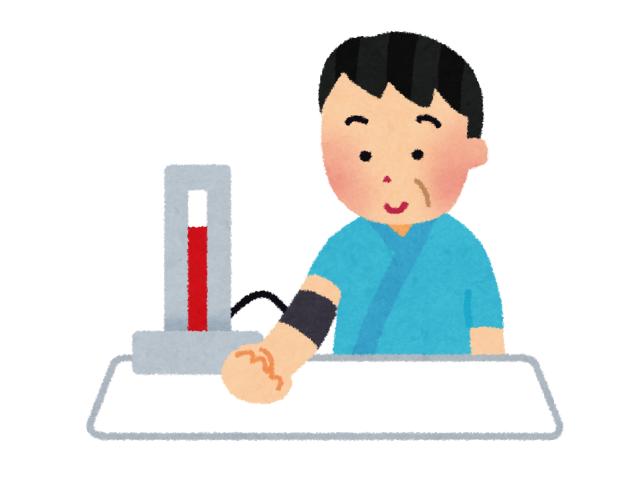血圧測定をしている男性